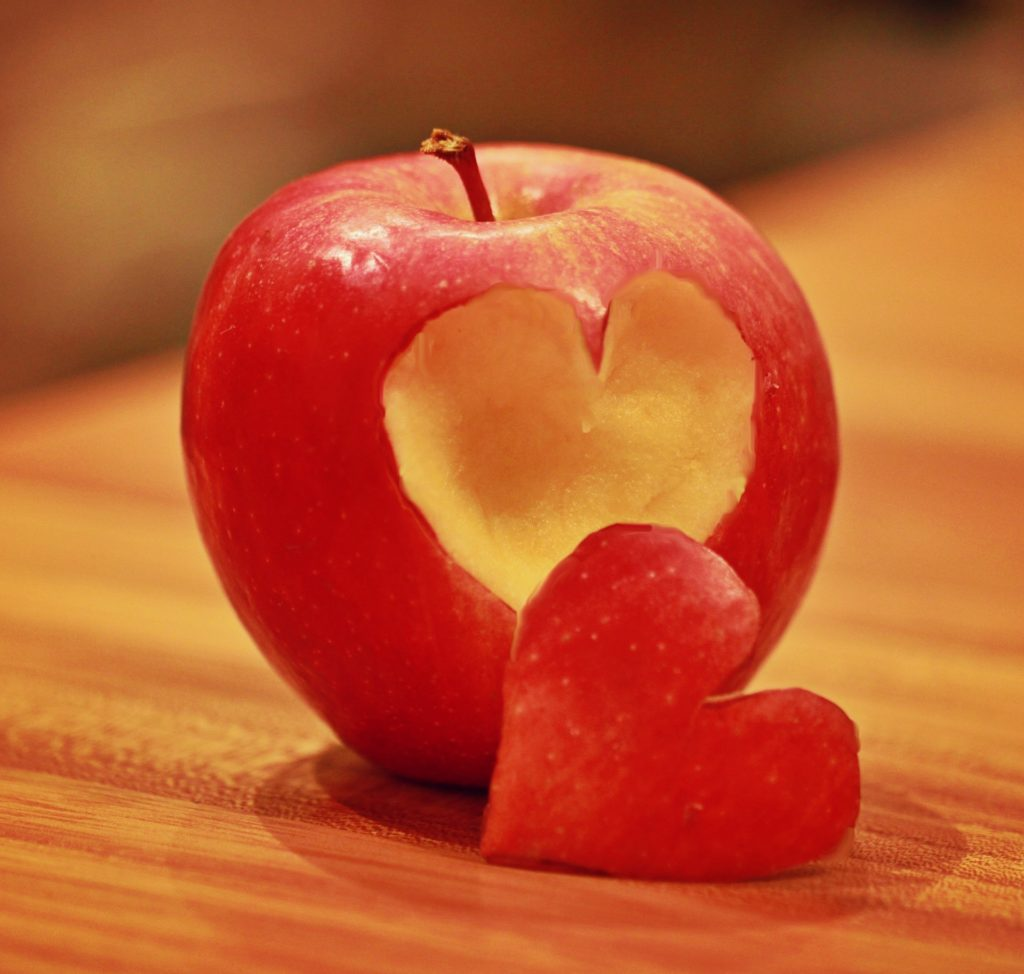apple with a heart shaped piece cut out