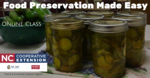 Jars of home canned pickles, extension logo, cucumbers in colander,