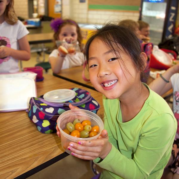 Girl eating lunch - fruit